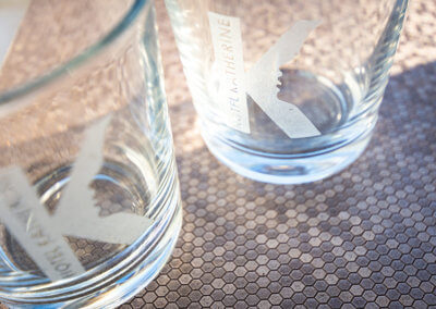 Close up photograph of Hotel Katherine branded glasses
