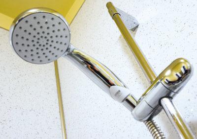 Close up photograph of a chrome showerhead